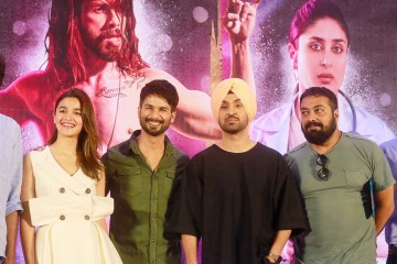 """Bollywood film """"Udta Punjab,"""" or """"Flying Punjab"""" actors from left, Alia Bhatt,  Shahid Kapoor and Diljit Dosanjh along with film producer Anurag Kashyap pose for photographs after a press conference of the film in Mumbai, India, Tuesday, June 14, 2016. The Bollywood movie about drug abuse in India's northern state of Punjab can be released in theaters across the country with one potentially offensive scene removed, rather than the many cuts sought by censors, a court ruled Monday. The director and producers of the film had appealed to the court last week after the Censor Board sought removal of nearly 90 scenes before it would declare the film fit for screening.(AP Photo/Rafiq Maqbool)"""