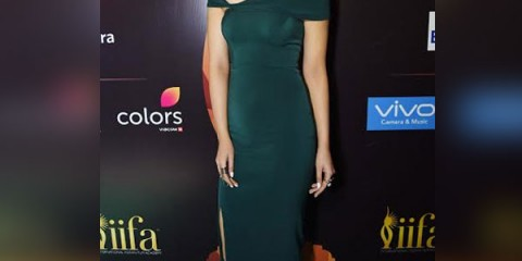 Kriti-Sanon-in-a-Rutu-Neeva-green-dress-for-IIFA-2017-press-conference-5