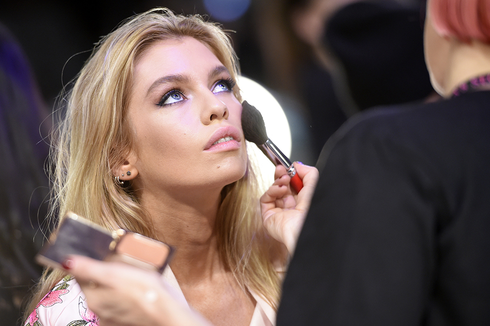 SHANGHAI, CHINA - NOVEMBER 20:  Model Devon Windsor prepares backstage during 2017 Victoria's Secret Fashion Show In Shanghai at Mercedes-Benz Arena on November 20, 2017 in Shanghai, China.  (Photo by Kevin Mazur/Getty Images for Victoria's Secret)
