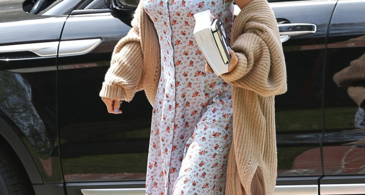 Los Angeles, CA  - Selena Gomez heads to Sunday church service on Easter. Selena looks church ready in a long knit cardigan, a floral printed dress, and white sneakers.  Pictured: Selena Gomez  BACKGRID USA 1 APRIL 2018   USA: +1 310 798 9111 / usasales@backgrid.com  UK: +44 208 344 2007 / uksales@backgrid.com  *UK Clients - Pictures Containing Children Please Pixelate Face Prior To Publication*