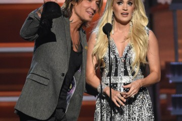 "Mandatory Credit: Photo by Chris Pizzello/Invision/AP/REX/Shutterstock (9630041ct) Keith Urban, Carrie Underwood. Keith Urban, left, and Carrie Underwood accept the award for vocal event of the year for ""The Fighter"" at the 53rd annual Academy of Country Music Awards at the MGM Grand Garden Arena, in Las Vegas 53rd Annual Academy Of Country Music Awards - Show, Las Vegas, USA - 15 Apr 2018"