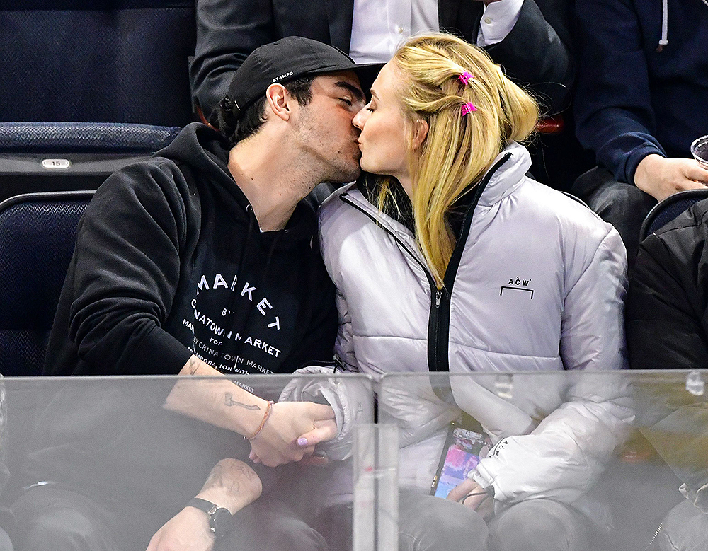 Mandatory Credit: Photo by JD Images/REX/Shutterstock (10160890bt) Joe Jonas and Sophie Turner Celebrities at Detroit Red Wings v New York Rangers, NHL ice hockey match, New York, USA - 19 Mar 2019 At one point Sophie impressed by the crowd by quickly drinking (and spilling) a glass of wine while being put on the Jumbotron