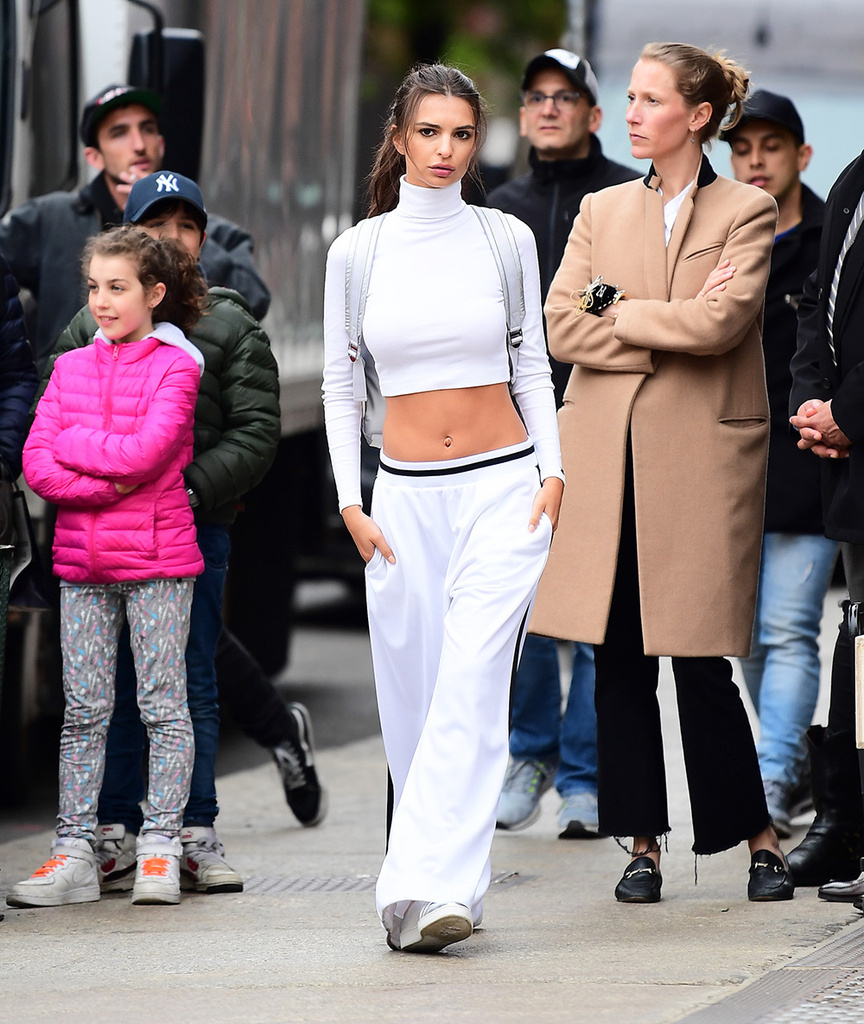 Emily Ratajkowski was spotted shooting a campaign for DKNY on Monday. She showed off her perfectly toned abs as she posed in a white droptop sweatsuit, with a DKNY backpack. She looked smoking hot in the ensemble shooting on the streets of Soho. Pictured: Emily Ratajkowski Ref: SPL1484572 240417 NON-EXCLUSIVE Picture by: SplashNews.com Splash News and Pictures Los Angeles: 310-821-2666 New York: 212-619-2666 London: 0207 644 7656 Milan: 02 4399 8577 photodesk@splashnews.com World Rights